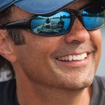 Image of author in sun glasses and blue hat